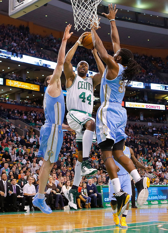 . BOSTON, MA - FEBRUARY 10: Chris Wilcox #44 of the Boston Celtics drives to the basket in front of Kenneth Faried #35 of the Denver Nuggets during the game on February 10, 2013 at TD Garden in Boston, Massachusetts.  (Photo by Jared Wickerham/Getty Images)