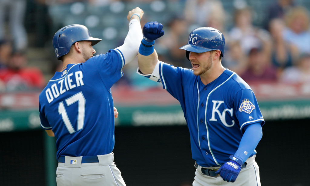 . Kansas City Royals\' Ryan O\'Hearn, right, and Hunter Dozier celebrate after O\'Hearn hit a two-run home run off Cleveland Indians starting pitcher Adam Plutko in the sixth inning of a baseball game, Monday, Sept. 3, 2018, in Cleveland. Dozier scored on the play. (AP Photo/Tony Dejak)