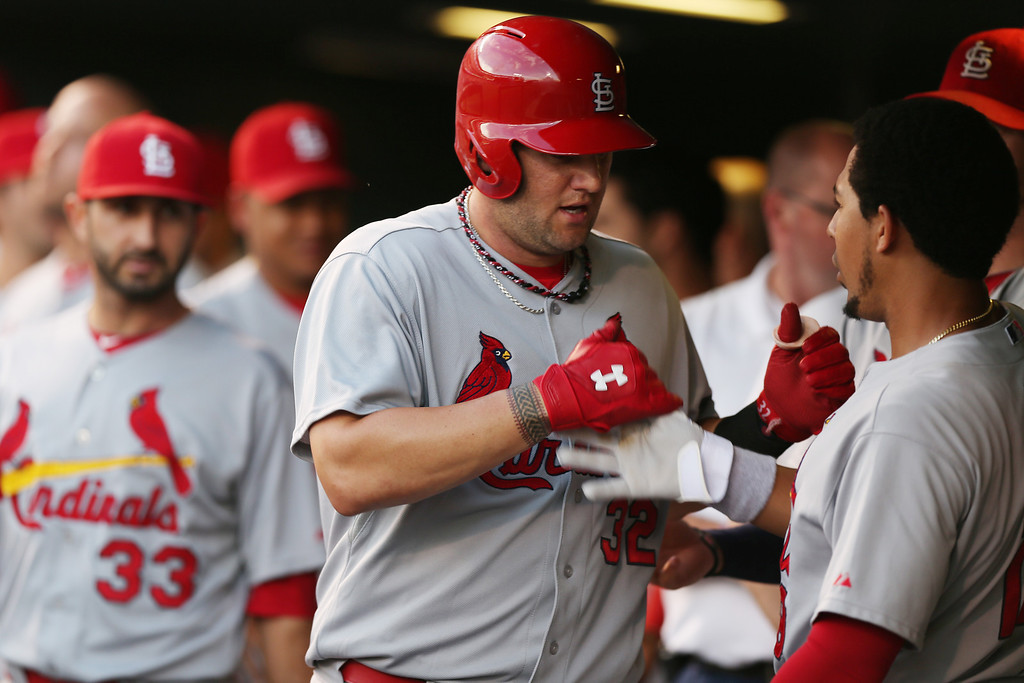. St. Louis Cardinals\' Matt Adams is congratulated by teammates after hitting a solo home run against the Colorado Rockies in the fifth inning of a baseball game in Denver on Monday, June 23, 2014. (AP Photo/David Zalubowski)