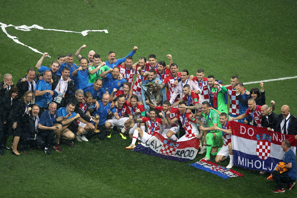 . Croatia players pose for photos at the end of the final match between France and Croatia at the 2018 soccer World Cup in the Luzhniki Stadium in Moscow, Russia, Sunday, July 15, 2018. (AP Photo/Thanassis Stavrakis)