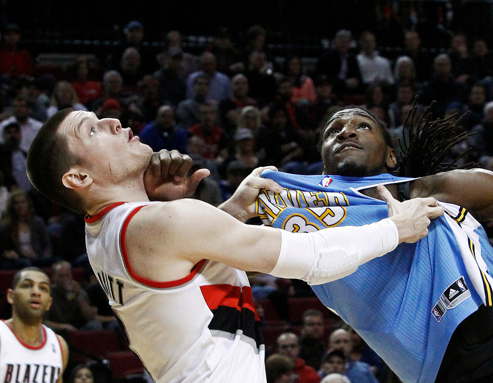 . Portland Trail Blazers forward Luke Babbitt, left, and Denver Nuggets forward Kenneth Faried battle for rebound position under the basket during the first quarter of an NBA basketball game in Portland, Ore., Thursday, Dec. 20, 2012. (AP Photo/Don Ryan)
