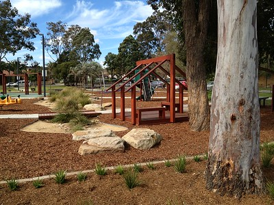 boulder and grass swale with timber bridge and open plan cubby