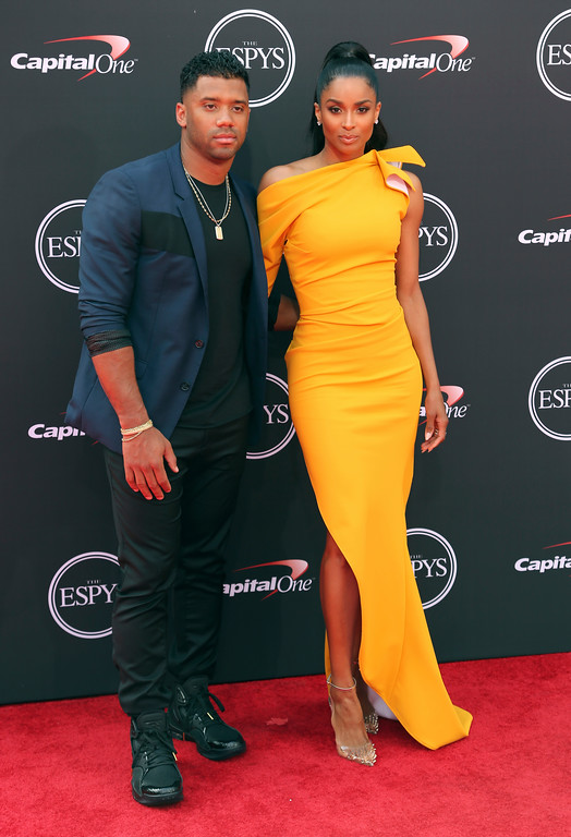 . Seattle Seahawks\' Russell Wilson, left, and Ciara arrive at the ESPY Awards at Microsoft Theater on Wednesday, July 18, 2018, in Los Angeles. (Photo by Willy Sanjuan/Invision/AP)