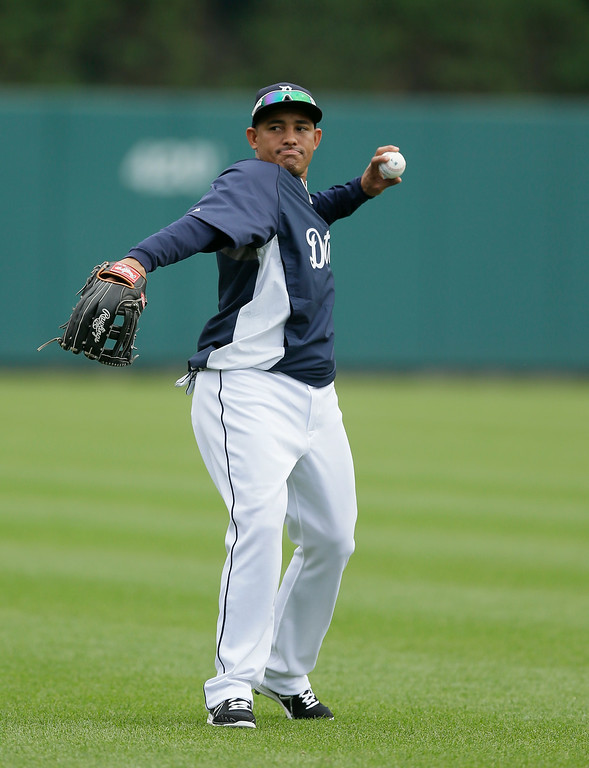 . Detroit Tigers left fielder Ezequiel Carrera warms up before an interleague baseball game against the Colorado Rockies, Friday, Aug. 1, 2014, in Detroit. (AP Photo/Carlos Osorio)