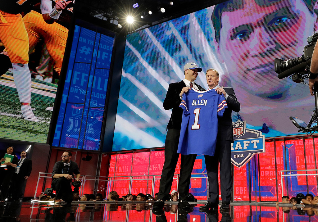 . Wyoming\'s Josh Allen, left, is presented with his Buffalo Bills jersey by Commissioner Roger Goodell during the first round of the NFL football draft, Thursday, April 26, 2018, in Arlington, Texas. (AP Photo/David J. Phillip)