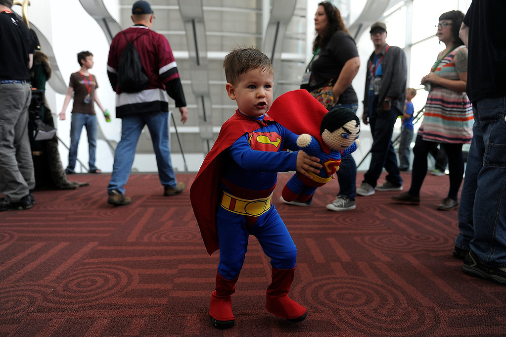 . DENVER, CO - JUNE 1: Liam Stewart, 2, plays with a plush Superman doll during Denver Comic Con at the Colorado Convention Center on June 1, 2013 in Denver, Colorado. (Photo by Seth McConnell/The Denver Post)