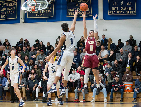 01/17/20 Wesley Bunnell | StaffrrNew Britain boys basketball was defeated at East Catholic on Friday night at East Catholic High School. Justice Carter (0)