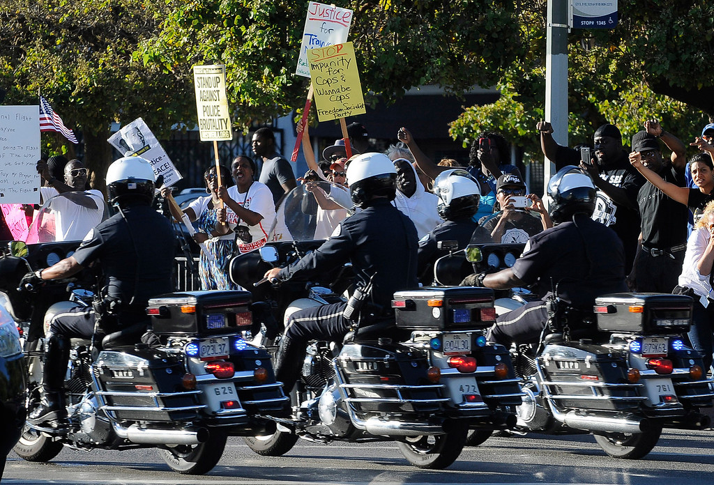 . Protestors shout at LAPD Motor Officers as they drive down Crenshaw Blvd. Crowds gather to protest while a heavy presence of Los Angeles Police Officers patrols the area around Leimert Park at the intersection of, Crenshaw Boulevard and Vernon in Los Angeles, CA. 7/16/2013(John McCoy/LA Daily News)