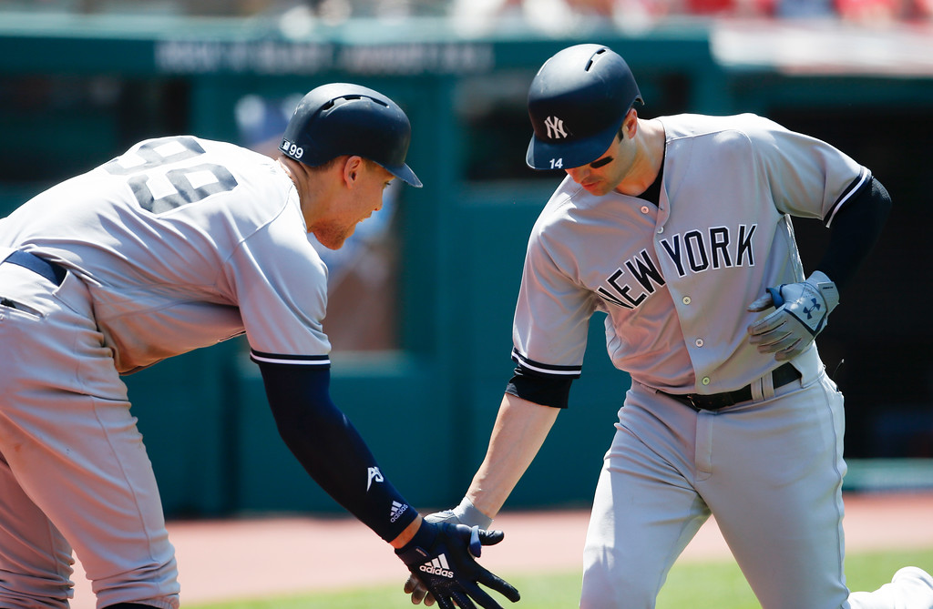 . New York Yankees\' Neil Walker celebrates with Aaron Judge (99) after hitting a solo home run off Cleveland Indians starting pitcher Trevor Bauer during the fourth inning of a baseball game, Sunday, July 15, 2018, in Cleveland. (AP Photo/Ron Schwane)
