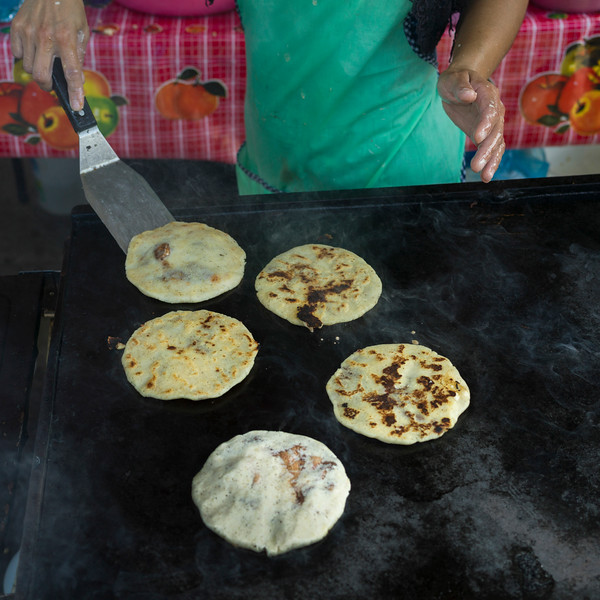 Person baking Pupusas, a traditional flatbread, San Ignacio, Belize