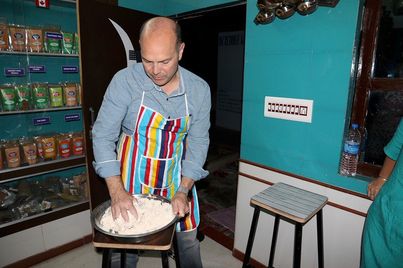 Michael kneading the dough to make chapati (Indian bread) - Incredible Krishna Cooking Class - Jodpur