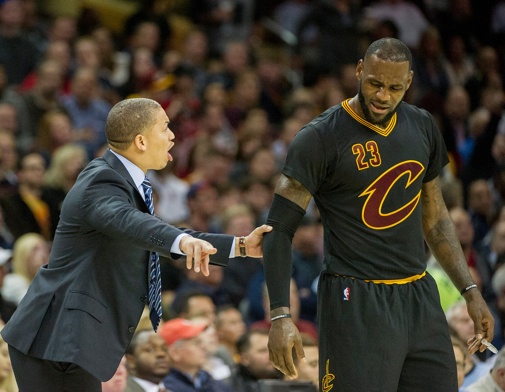 . Cleveland Cavaliers head coach Tyronn Lue speaks with LeBron James during the second half of an NBA  basketball game against the Atlanta Hawks in Cleveland, Tuesday, Nov. 8, 2016. The Hawks won 110-106. (AP Photo/Phil Long)