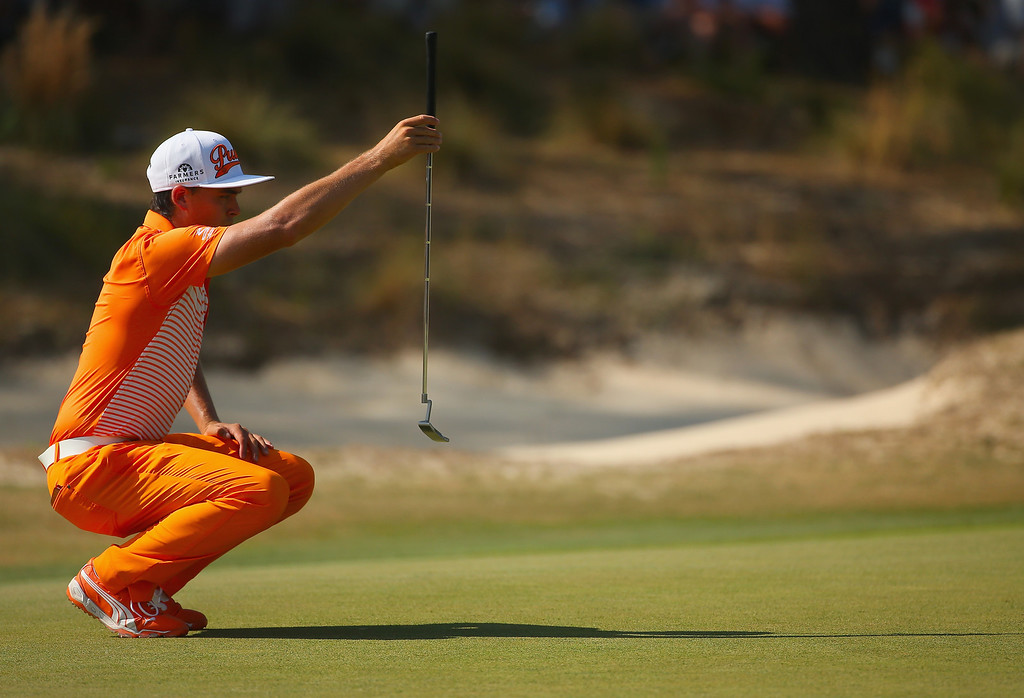 . PINEHURST, NC - JUNE 15: Rickie Fowler of the United States lines up his putt on the fifth green during the final round of the 114th U.S. Open at Pinehurst Resort & Country Club, Course No. 2 on June 15, 2014 in Pinehurst, North Carolina.  (Photo by Mike Ehrmann/Getty Images)