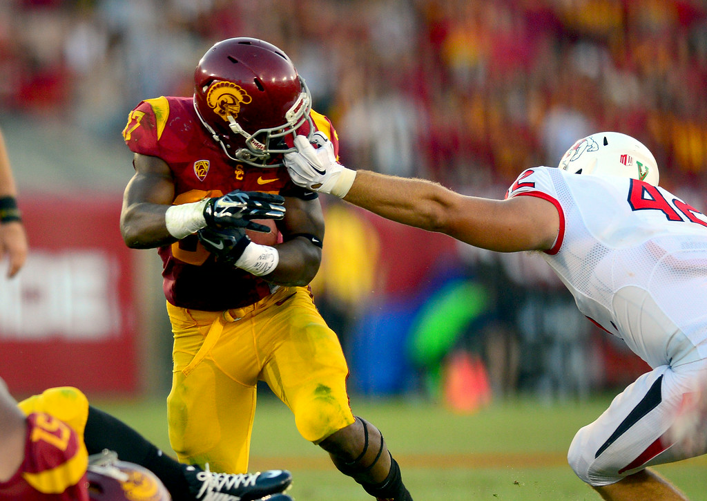 . USC RB Javorius Allen is face masked by Fresno State\'s Jeff Camilli in the third-quarter, Saturday, August 30, 2014, at the L.A. Memorial Coliseum. (Photo by Michael Owen Baker/Los Angeles Daily News)