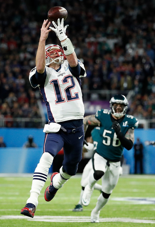 . New England Patriots quarterback Tom Brady can\'t catch a pass on a flea flicker during the first half of the NFL Super Bowl 52 football game against the Philadelphia Eagles Sunday, Feb. 4, 2018, in Minneapolis. (AP Photo/Matt York)
