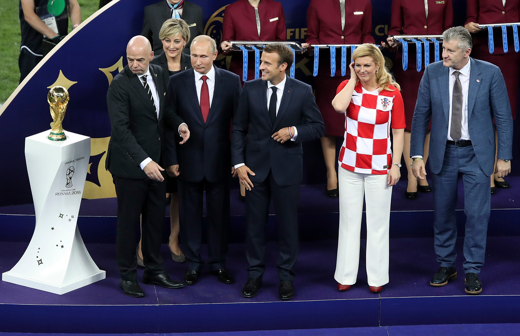 . FIFA President Gianni Infantino, Russian President Vladimir Putin, French President Emmanuel Macron and Croatian President Kalinda Grabar-Kitarovic, from left to right, stand next to the trophy at the end of the final match between France and Croatia at the 2018 soccer World Cup in the Luzhniki Stadium in Moscow, Russia, Sunday, July 15, 2018. (AP Photo/Thanassis Stavrakis)