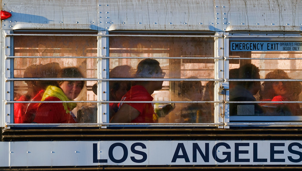 ". Protesters are driven off in a police bus after getting arrested during a wage protest in downtown Los Angeles on Tuesday, Nov. 29, 2016. Forty protesters were arrested as they blocked a downtown Los Angeles intersection as part of a national wave of demonstrations in support of higher wages and workers\' rights. About a hundred demonstrators formed a circle in the street early Tuesday and hoisted signs saying ""the whole world is watching\"" and \""Fight for $15.\"" (AP Photo/Richard Vogel)"