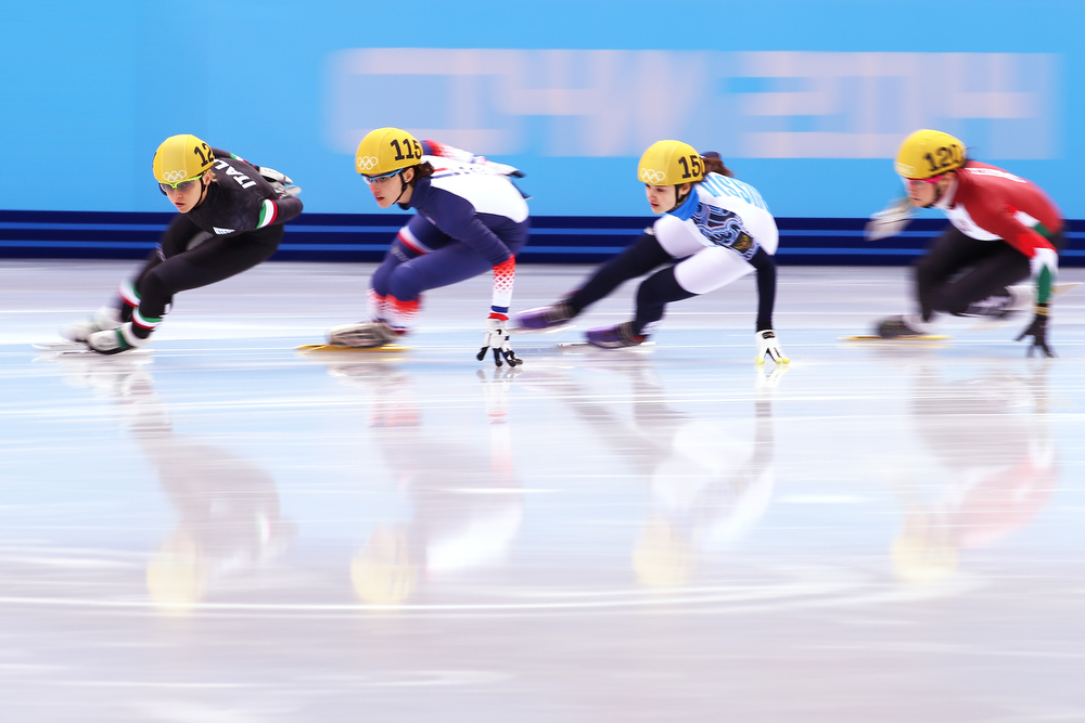 . Arianna Fontana of Italy, Veronique Pierron of France, Sofia Prosvirnova of Russia and Bernadett Heidum of Hungary compete in the Short Track Ladies\' 1000m Heat at Iceberg Skating Palace on day 11 of the 2014 Sochi Winter Olympics on February 18, 2014 in Sochi, Russia.  (Photo by Streeter Lecka/Getty Images)