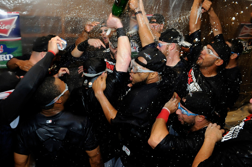 . MINNEAPOLIS, MN - SEPTEMBER 29: The Cleveland Indians celebrate with champagne after a win of the game against the Minnesota Twins on September 29, 2013 at Target Field in Minneapolis, Minnesota. The Indians defeated the Twins 5-1 and clinched a American League Wild Card berth. (Photo by Hannah Foslien/Getty Images)