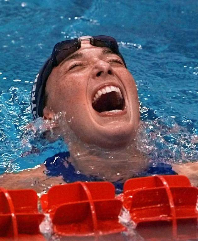 . Amy Van Dyken of United States reacts after winning the gold medal in the women\'s 100 meter butterfly final at the 1996 Summer Olympics in Atlanta, Tuesday, July 23, 1996.  (AP Photo/Lynne Sladky)