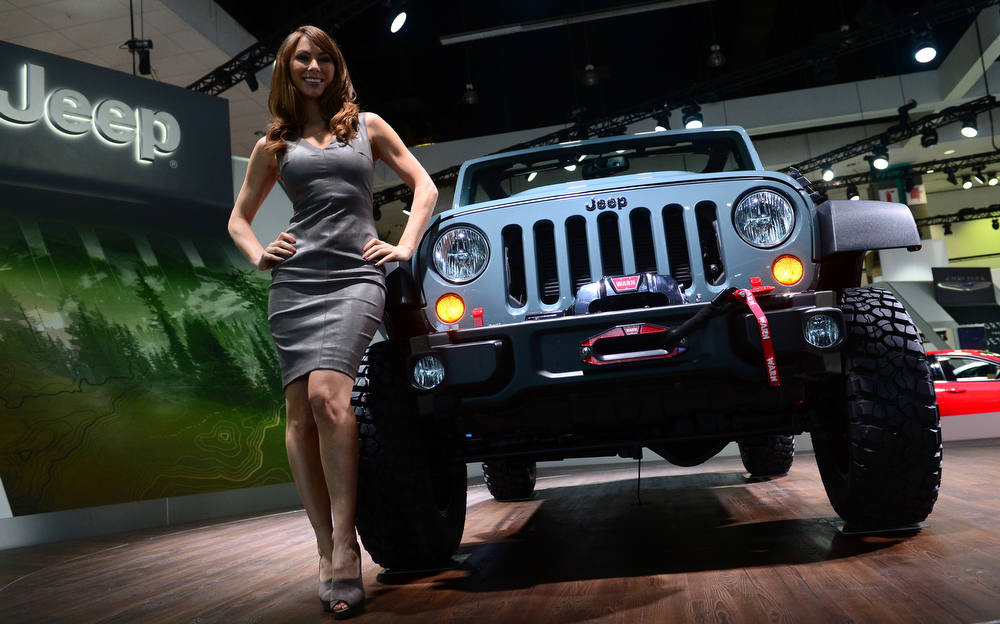 Description of . A model poses beside the new Jeep Wrangler 10th anniversary Rubicon edition displayed on media preview day at the Los Angeles Auto Show on November 28, 2012 in Los Angeles, California. The show opens to the public from November 30 to December 9. AFP PHOTO / Frederic J.  BROWN/AFP/Getty Images