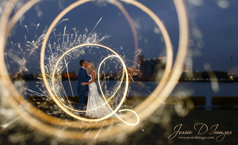 Bride and groom kiss - newcastle photography - newcastle wedding - newcastle lights harbour - sparkler photo