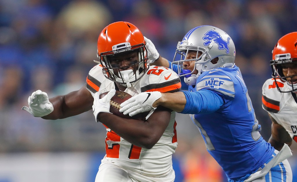 . Detroit Lions defensive back Sterling Moore tackles Cleveland Browns running back Matt Dayes (27) during the first half of an NFL football preseason game, Thursday, Aug. 30, 2018, in Detroit. (AP Photo/Paul Sancya)