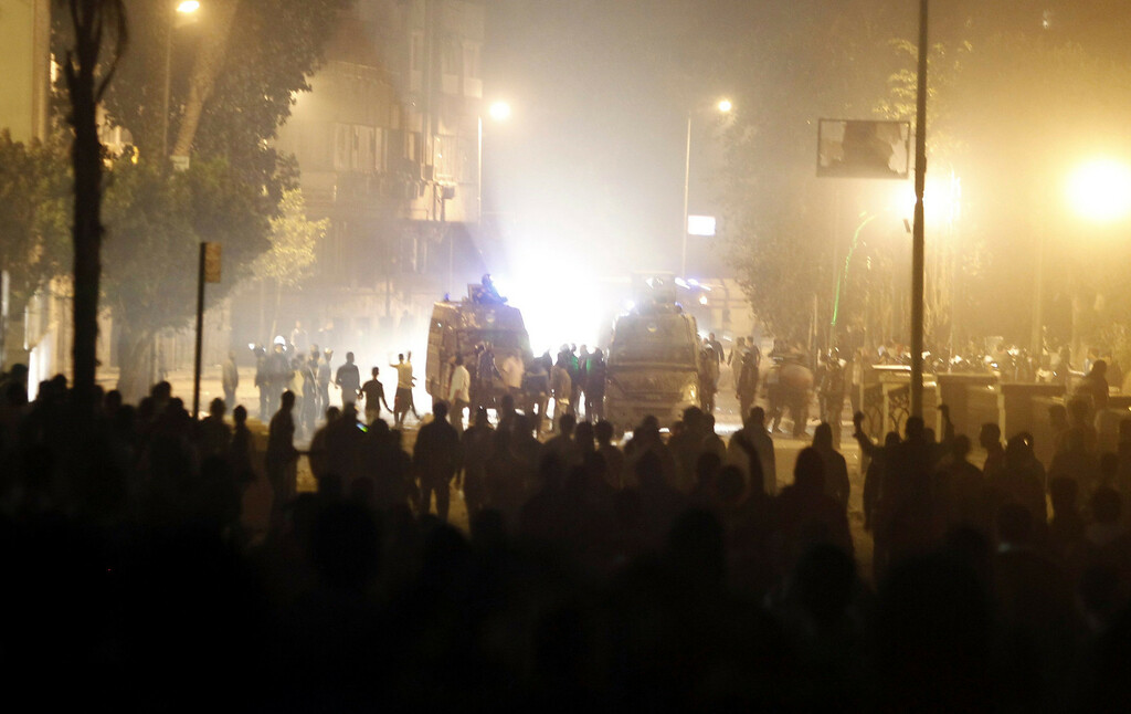 . Protesters, who oppose Egyptian President Mohamed Mursi, face riot police during clashes along Qasr Al Nil bridge, which leads to Tahrir Square in Cairo March 9, 2013. REUTERS/Amr Abdallah Dalsh