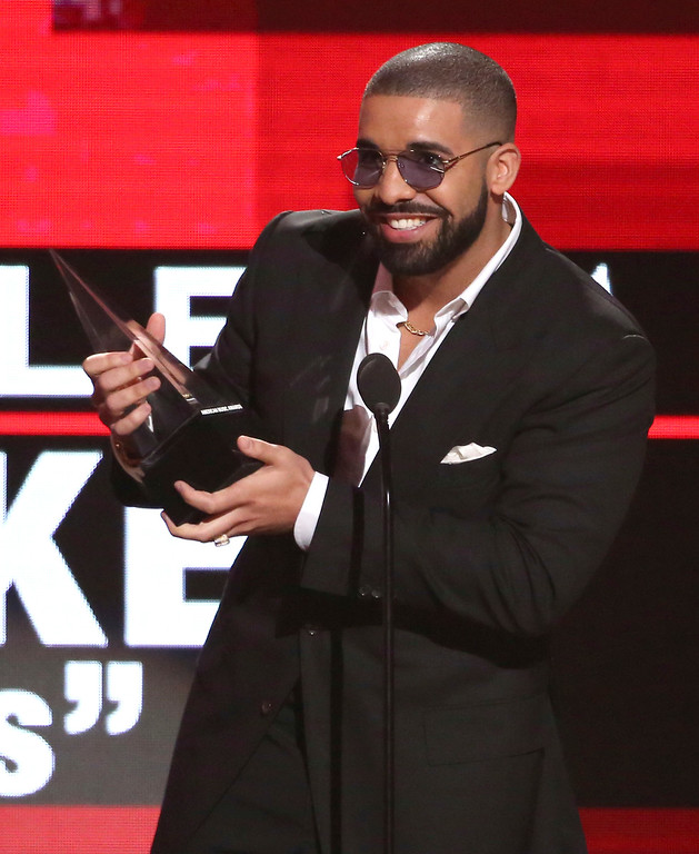 ". Drake accepts the award for favorite album rap/hip-hop for ""Views\"" at the American Music Awards at the Microsoft Theater on Sunday, Nov. 20, 2016, in Los Angeles. (Photo by Matt Sayles/Invision/AP)"