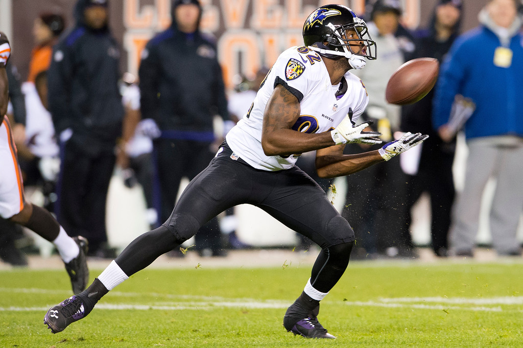 . Wide receiver Torrey Smith #82 of the Baltimore Ravens catches a 46 yard pass  during the first half against the Cleveland Browns at FirstEnergy Stadium on November 3, 2013 in Cleveland, Ohio. (Photo by Jason Miller/Getty Images)