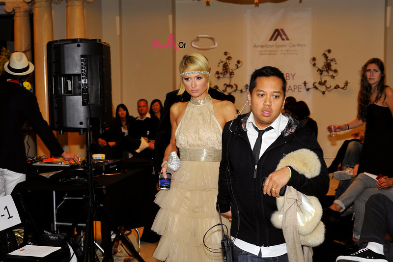"""Paris lead into Fashion Show. Photograph of Paris Hilton dressed as flapper attending Oscar Party with IS VODKA www.ISVodka.com and  fashion show featuring  Russel Simmons new clothes line """"Argyle Culture."""""""