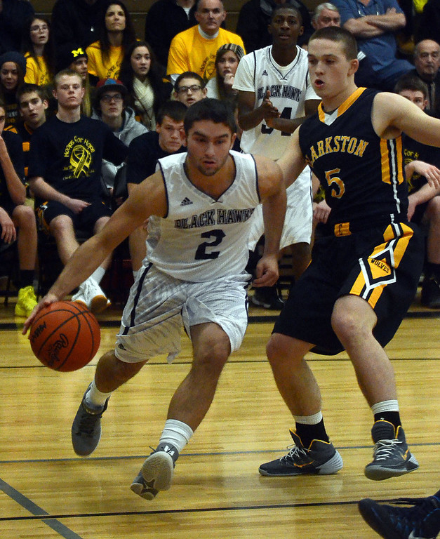 . Bloomfield Hills #2 Dylan Deitch drives the baseline past Clarkston\'s #5 Andrew Myers during their game at Bloomfield Hills High School, Tuesday January 28, 2014. Bloomfield Hills went on to win the game 74-62. (Vaughn Gurganian-The Oakland Press)