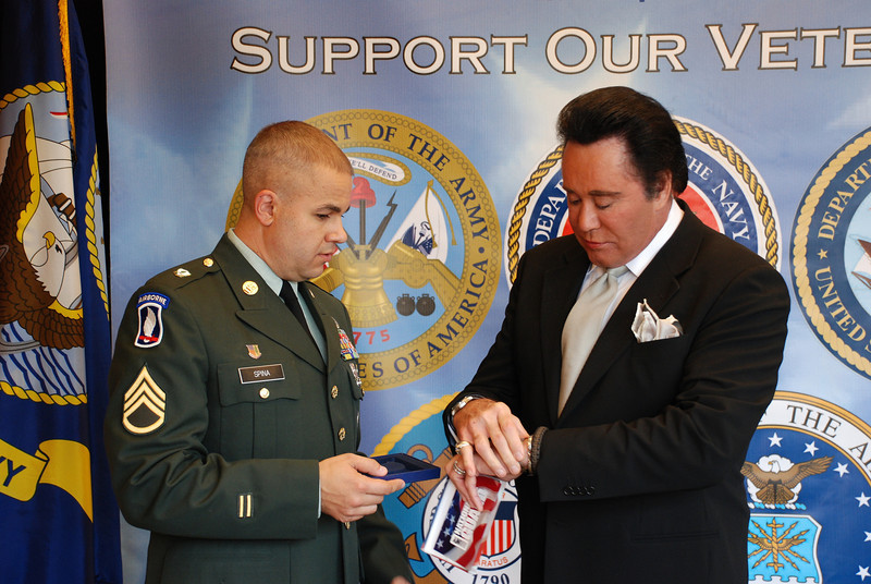 SSG Mark Spina presents Wayne a bracelet