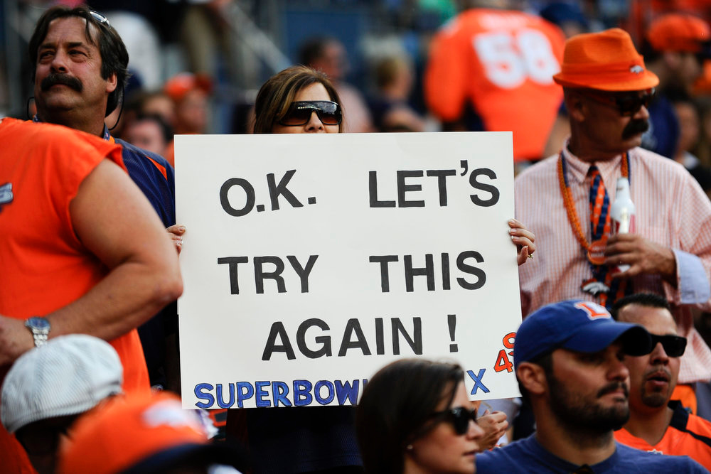 . A fan holds a sign before the start of a preseason game between the Denver Broncos and the Seattle Seahawks at Sports Authority Field at Mile High on Thursday, August 07, 2014 in Denver, Colorado.  (Photo by Kent Nishimura/The Denver Post)