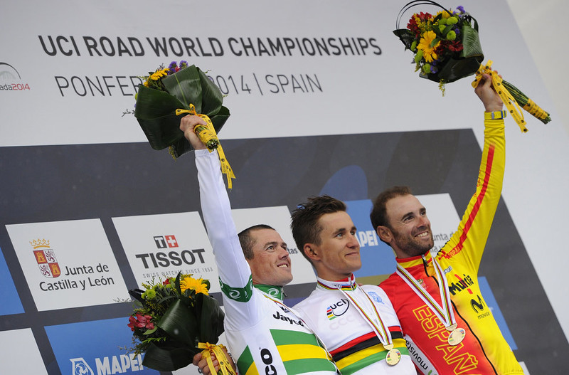 . Gold medalist Poland\'s Michal Kwiatkowsk (C), silver medalist Australia\'s Simon Gerrans (L) and bronze medalist Spain\'s Alejandro Valverde celebrate on podium of the men\'s road race at the 2014 UCI Road World Championships in Ponferrada on September 28, 2014.  MIGUEL RIOPA/AFP/Getty Images