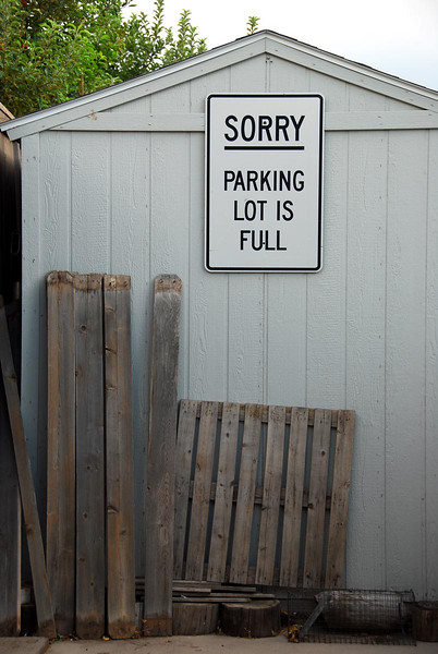 7/29/07 – When Logan was in his early teens he would always bring strange things home. This sign is one of those things. I hung it on the shed a few years ago because we had so many cars parked in the driveway.