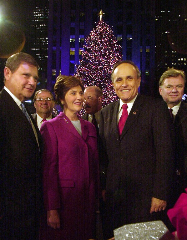 . First lady Laura Bush stands next to New York City Mayor Rudolph Giuliani, second from right, after lighting the Rockefeller Center Christmas tree at the annual tree lighting ceremony Wednesday, Nov. 28, 2001, in New York. Standing from left are Jerry I. Speyer, president and CEO of Tishman Speyer properties, Bush, Giuliani and Thomas Von Essen, New York City Fire Commissioner. (AP Photo/Ed Bailey)