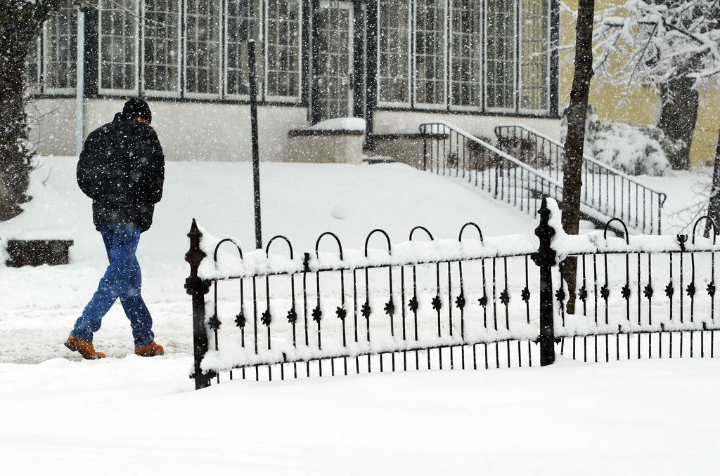 . A pedestrian makes his way along South Broad Street in Lansdale during snowstorm.      Monday, February 3, 2014.  Photo by Geoff Patton