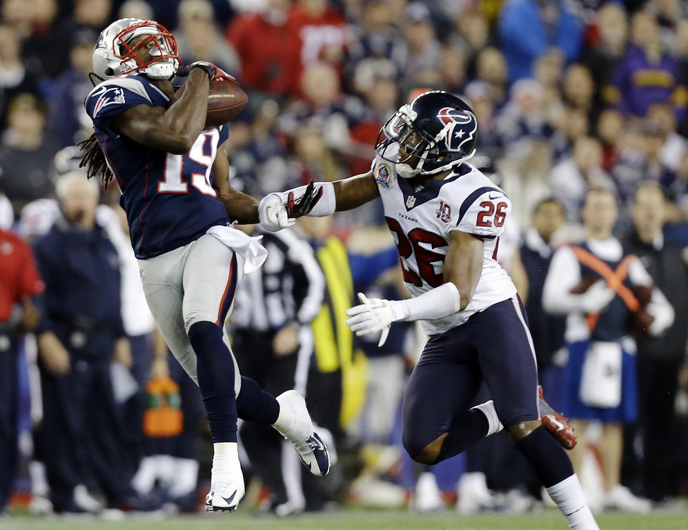 . New England Patriots wide receiver Donte\' Stallworth (19) catches a pass in front of Houston Texans defensive back Brandon Harris (26) before running it in for a touchdown during the third quarter of an NFL football game in Foxborough, Mass., Monday, Dec. 10, 2012. (AP Photo/Elise Amendola)