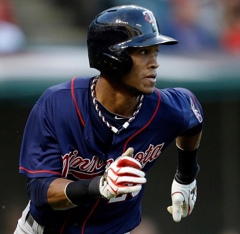 . Minnesota\'s Pedro Florimon runs out an RBI double off Indians starter Ubaldo Jimenez in the second inning, knocking in Clete Thomas. (AP Photo/Tony Dejak)