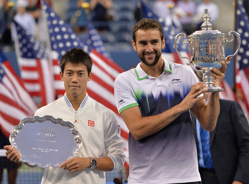 . Marin Cilic of Croatia(R) and Kei Nishikori of Japan hold their awards after their US Open 2014 men\'s singles finals match at the USTA Billie Jean King National Center September 8, 2014  in New York. STAN HONDA/AFP/Getty Images