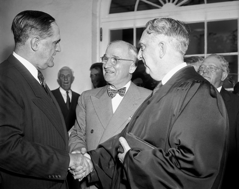 . Pres. Harry S. Truman, center, and Chief Justice Fred Vinson, right, congratulates Sherman Minton, left, outside the White House after Minton was sworn in by Vinson as an Associate Justice of the Supreme Court, Oct. 12, 1949, Washington, D.C. Mr. Truman told the crowd that the duty of handing Minton his commission is one of the most pleasurable in my political career. (AP Photo/John Rous)