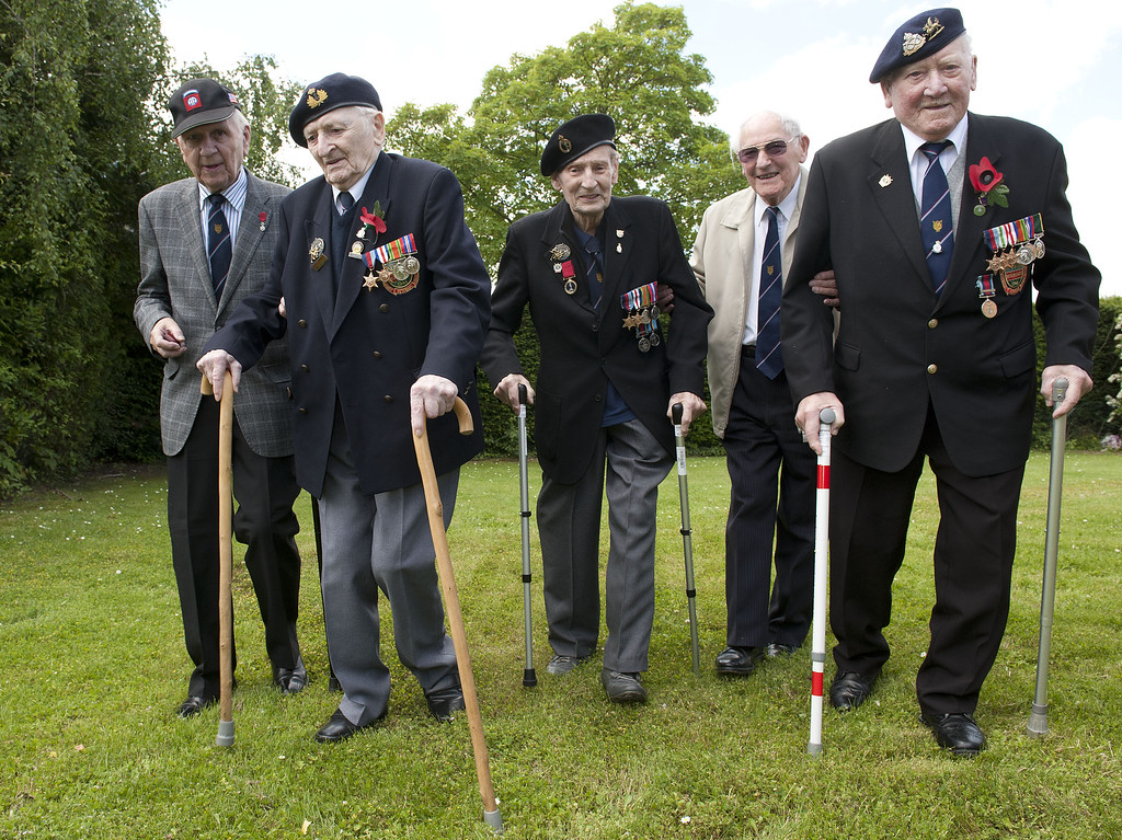 . CAEN, FRANCE - JUNE 06:   Members of the 16th Walsall branch of the Normandy veteran\'s asscoiation arrive in (LtoR) sgt Ken Reynolds (90), Able Seaman Ronald Davies (88), Signalman Gordon Poole (89), Sub lt rnbr Geoff Ensor (90) and  Corporal Frank Corbett (93) arrive for D-Day 70 Commemorations on June 6, 2014 in Caen, France. Friday 6th June is the 70th anniversary of the D-Day landings which saw 156,000 troops from the allied countries including the United Kingdom and the United States join forces to launch an audacious attack on the beaches of Normandy,  these assaults are credited with the eventual defeat of Nazi Germany. A series of events commemorating the 70th anniversary are planned for the week with many heads of state travelling to the famous beaches to pay their respects to those who lost their lives. (Photo by Murray Sanders - Pool/Getty Images)