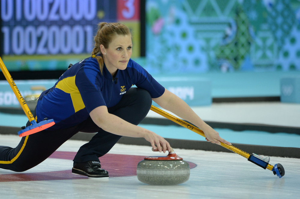 . Sweden\'s Christina Bertrup throws the stone during the Women\'s Curling Gold Medal Game Sweden vs Canada at the Ice Cube Curling Center during the Sochi Winter Olympics on February 20, 2014.  JUNG YEON-JE/AFP/Getty Images