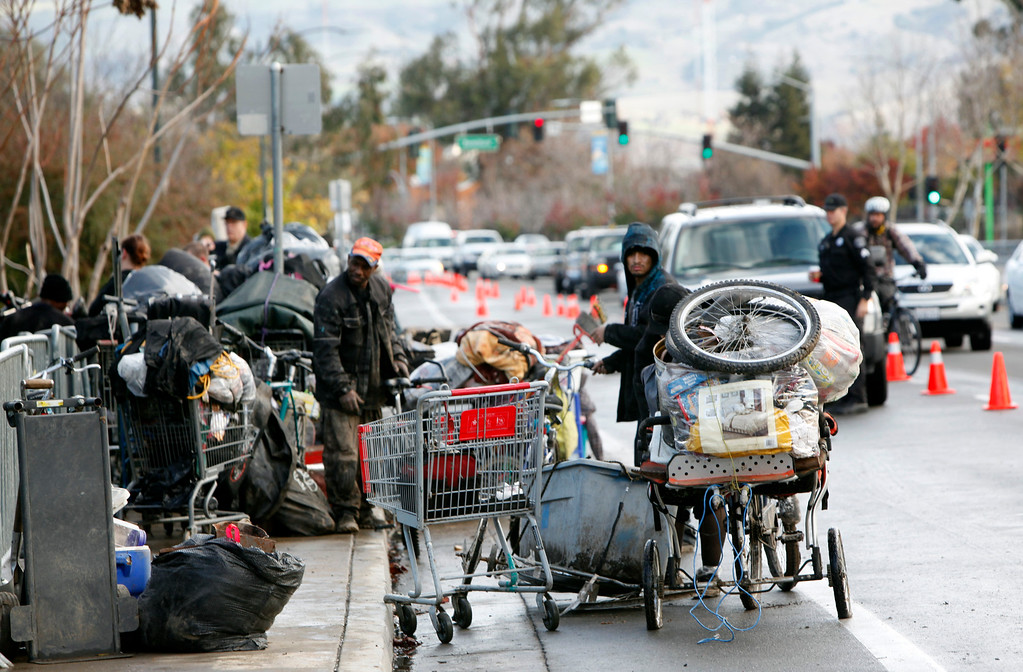 . Shopping carts of possessions line Story Road Thursday morning, Dec. 4, 2014, after residents of The Jungle move out of the huge homeless camp on Coyote Creek in San Jose, Calif. (Karl Mondon/Bay Area News Group)