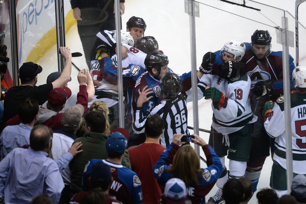 . The Colorado Avalanche and the Minnesota Wild mix it up during the second period of action. The Colorado Avalanche hosted the Minnesota Wild in the first round of the NHL playoffs at the Pepsi Center on Thursday, April 17, 2014. (Photo by Karl Gehring/The Denver Post)