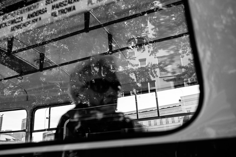 woman tram window reflection bnw mono warsaw city erik witsoe spring nikon d750 sigma 35mm.jpg