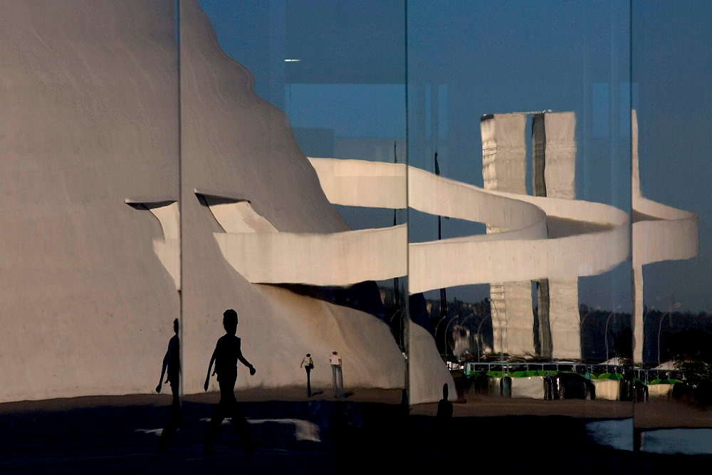 Description of . The National Museum and National Congress are reflected on the glass wall of the National Library, all designed by architect Oscar Niemeyer, in Brasilia, Brazil.(AP Photo/Eraldo Peres)