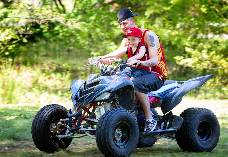 Jayden on 4 wheeler with dad.jpg