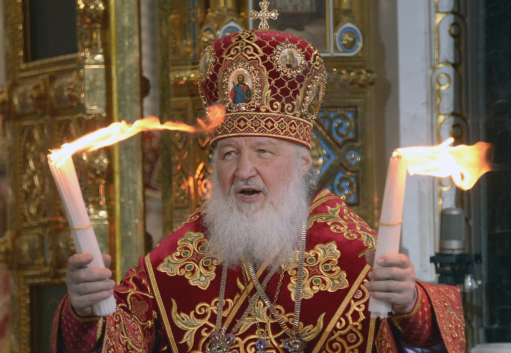 . Russian Orthodox Patriarch Kirill holds the Holly Light during an Orthodox Easter service in Moscow, early on April 20, 2014.  AFP PHOTO/ ALEXANDER NEMENOV/AFP/Getty Images
